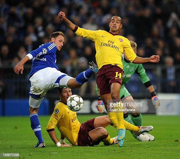 Theo Walcott of Arsenal goes past Shalke defender Benedikt Howedes to score his team's first goal during the UEFA Champions League Group B match...