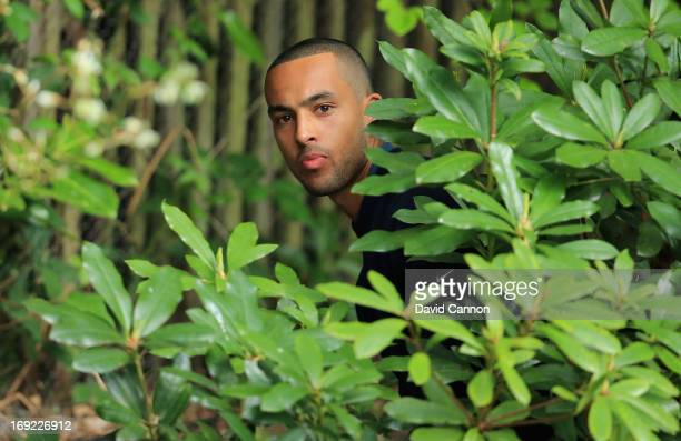 Theo Walcott of Arsenal hits from the bushes on the 4th hole during the ProAm round prior to the BMW PGA Championship on the West Course at Wentworth...