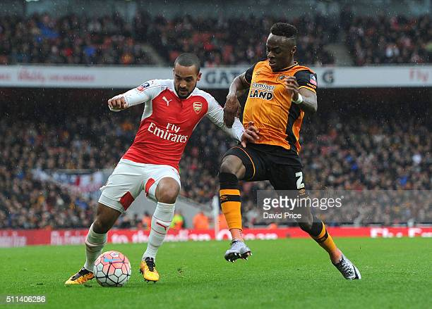 Theo Walcott of Arsenal holds off Moses Odubajo of Hull during the match between Arsenal and Hull City in the FA Cup 5th Round at Emirates Stadium on...