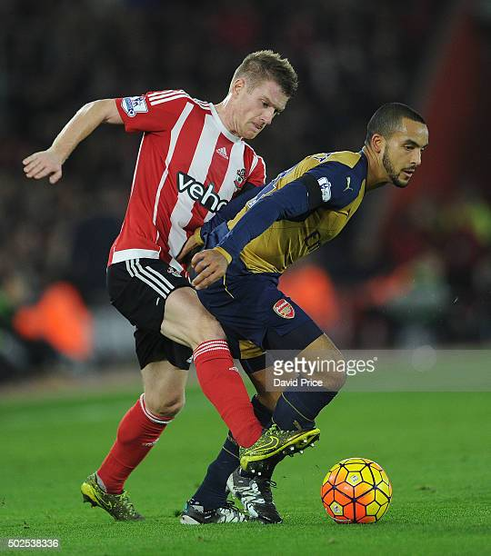 Theo Walcott of Arsenal holds off Steven Davis of Southampton during the Barclays Premier League match between Southampton and Arsenal at St Mary's...