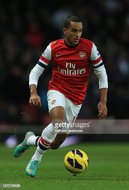 Theo Walcott of Arsenal in action during the Barclays Premier League match between Arsenal and Swansea City at the Emirates Stadium on December 1...