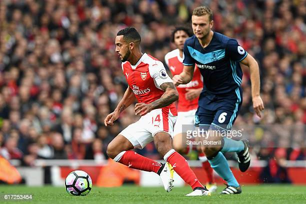 Theo Walcott of Arsenal is chased by Ben Gibson of Middlesbrough during the Premier League match between Arsenal and Middlesbrough at the Emirates...