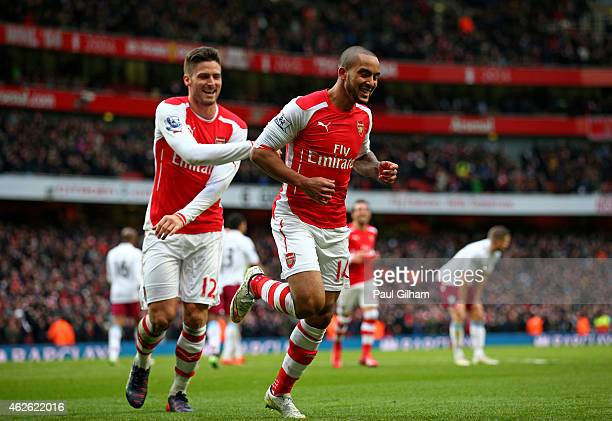 Theo Walcott of Arsenal is congratulated by teammate Olivier Giroud of Arsenal after scoring his team's third goal during the Barclays Premier League...