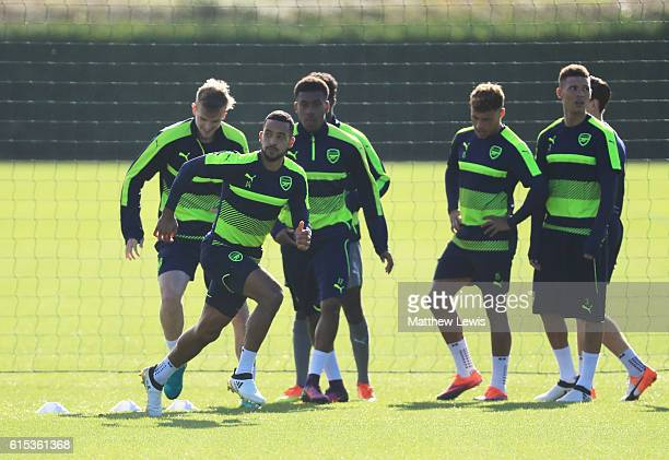 Theo Walcott of Arsenal peforms a drill with team mates during an Arsenal training session on the eve of their UEFA Champions League Group A match...