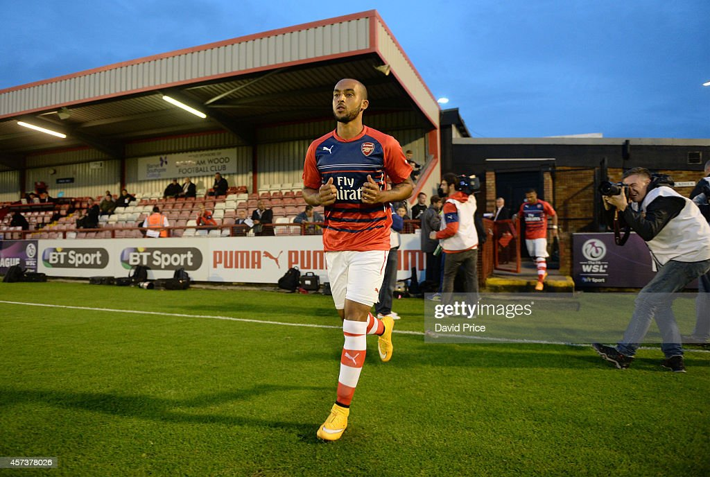 Theo Walcott of Arsenal runs out for the warm up before the match between Arsenal U21 and Blackburn U21 in the Barclays Premier U21 League at Meadow Park on October 17, 2014 in Borehamwood, England.