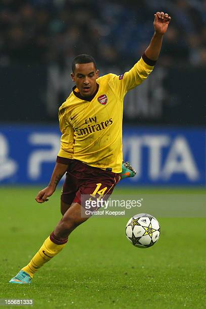Theo Walcott of Arsenal runs with the ball during the UEFA Champions League group B match between FC Schalke 04 and Arsenal FC at Veltins Arena on...