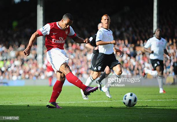 Theo Walcott of Arsenal scores during the Barclays Premier League match between Fulham and Arsenal at Craven Cottage on May 22, 2011 in London,...