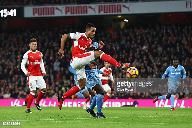Theo Walcott of Arsenal scores his sides first goal during the Premier League match between Arsenal and Stoke City at the Emirates Stadium on...