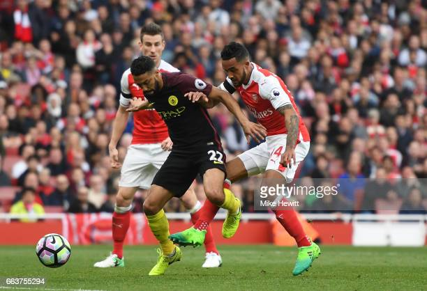 Theo Walcott of Arsenal scores his sides first goal during the Premier League match between Arsenal and Manchester City at Emirates Stadium on April...