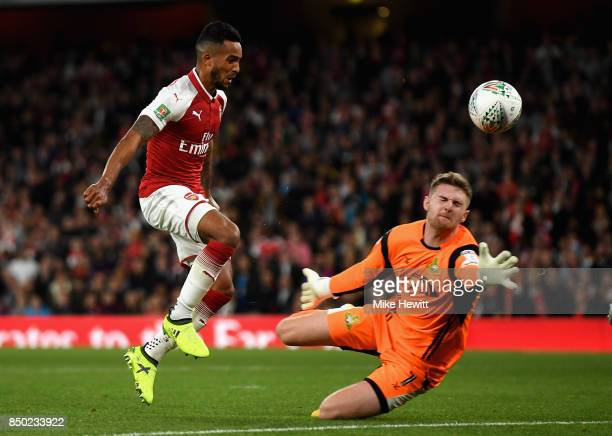 Theo Walcott of Arsenal scores his sides first goal past Ian Lawlor of Doncaster Rovers during the Carabao Cup Third Round match between Arsenal and...