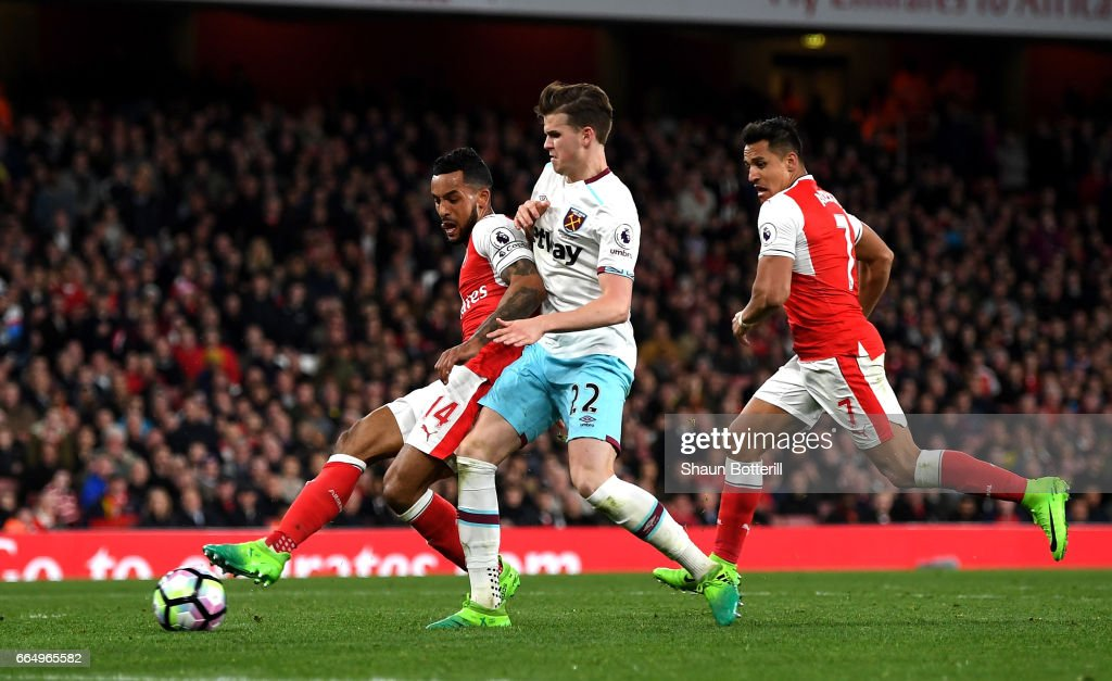 Theo Walcott of Arsenal scores his sides second goal during the Premier League match between Arsenal and West Ham United at the Emirates Stadium on April 5, 2017 in London, England.