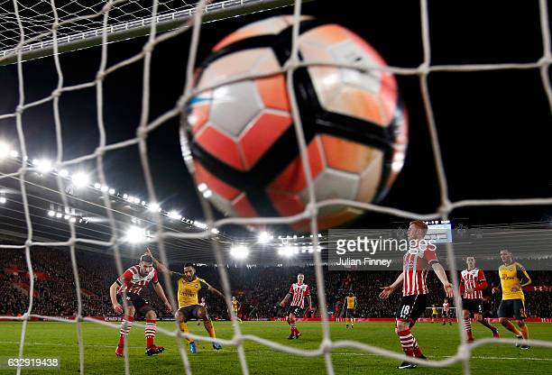 Theo Walcott of Arsenal scores his sides third goal during the Emirates FA Cup Fourth Round match between Southampton and Arsenal at St Mary's...