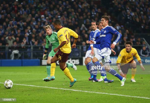 Theo Walcott of Arsenal scores his team's first goal during the UEFA Champions League group B match between FC Schalke 04 and Arsenal FC at...