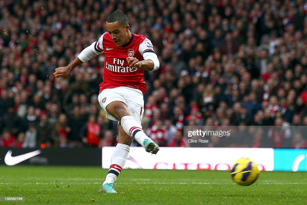 Theo Walcott of Arsenal scores his team's fofth goal during the Barclays Premier league match between Arsenal and Tottenham Hotspur at Emirates Stadium on November 17, 2012 in London, England.