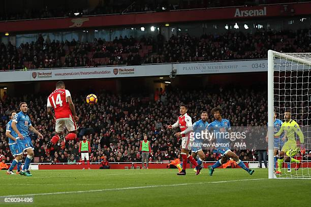 Theo Walcott of Arsenal scores his team's second goal during the Premier League match between Arsenal and AFC Bournemouth at Emirates Stadium on...