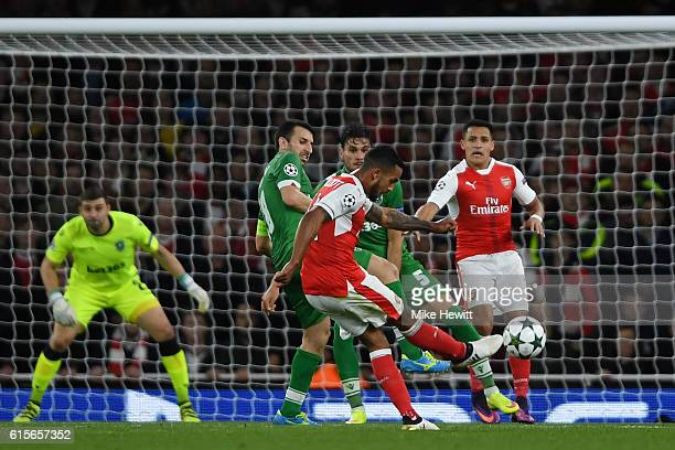Theo Walcott of Arsenal scores his team's second goal of the game during the UEFA Champions League group A match between Arsenal FC and PFC...