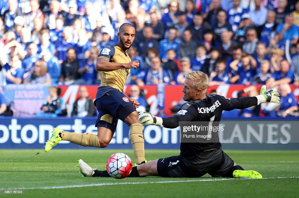 Theo Walcott of Arsenal scores past Kasper Schmeichel of Leicester City to make it 1-1 during the Barclays Premier League match between Leicester City and Arsenal at the King Power Stadium on September 26th, 2015 in Leicester, United Kingdom.