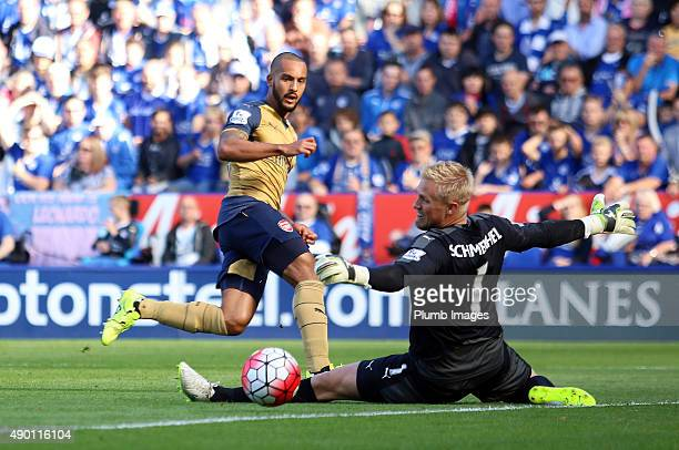 Theo Walcott of Arsenal scores past Kasper Schmeichel of Leicester City to make it 11 during the Barclays Premier League match between Leicester City...