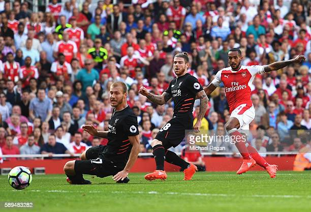 Theo Walcott of Arsenal scores the opening goal during the Premier League match between Arsenal and Liverpool at Emirates Stadium on August 14 2016...