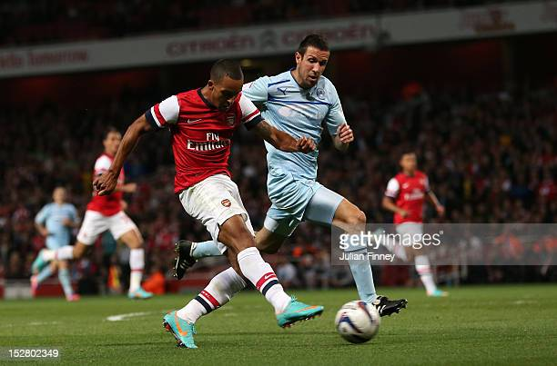 Theo Walcott of Arsenal scores their fourth goal during the Capital One Cup third round match between Arsenal and Coventry City at Emirates Stadium...