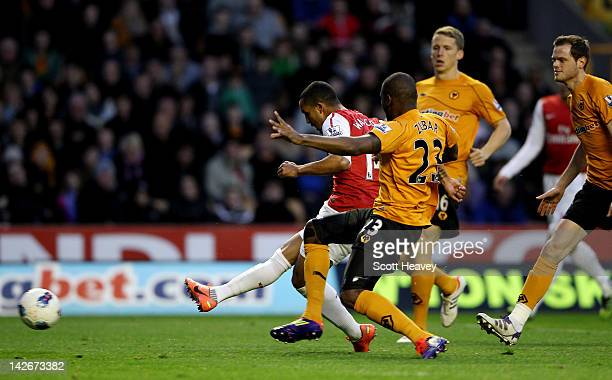 Theo Walcott of Arsenal scores their second goal during the Barclays Premier League match between Wolverhampton Wanderers and Arsenal at Molineux on...