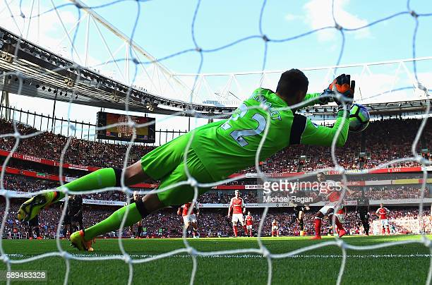 Theo Walcott of Arsenal sees his penalty saved by Simon Mignolet of Liverpool during the Premier League match between Arsenal and Liverpool at...