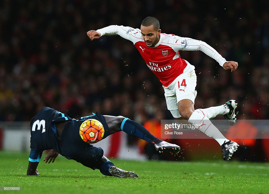 Theo Walcott of Arsenal skips a challenge by Bacary Sagna of Manchester City during the Barclays Premier League match between Arsenal and Manchester City at Emirates Stadium on December 21, 2015 in London, England.