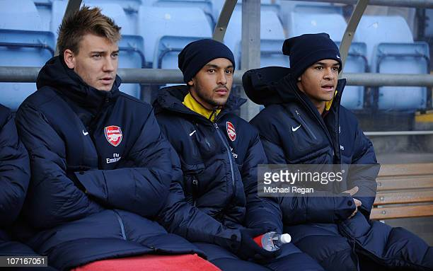Theo Walcott of Arsenal starts on the bench alongside Nicklas Bendtner and Denilson during the Barclays Premier League match between Aston Villa and...