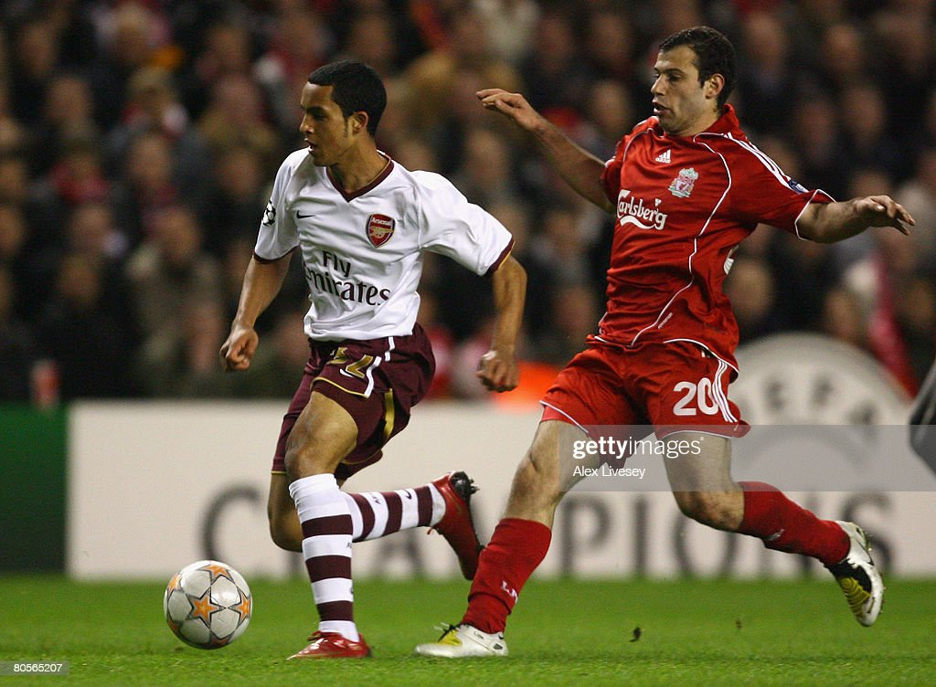 Theo Walcott of Arsenal surges away from Javier Mascherano of Liverpool during the UEFA Champions League Quarter Final, second leg match between Liverpool and Arsenal at Anfield on April 8, 2008 in Liverpool, England.