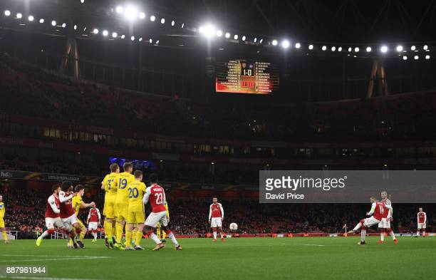 Theo Walcott of Arsenal takes a free kick during the UEFA Europa League group H match between Arsenal FC and BATE Borisov at Emirates Stadium on...