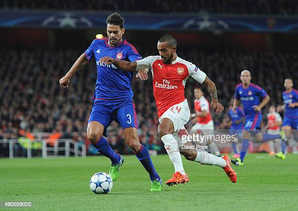 Theo Walcott of Arsenal takes on Alberto Botia of Olympiacos during the match between Arsenal and Olympiacos on September 29 2015 in London United...