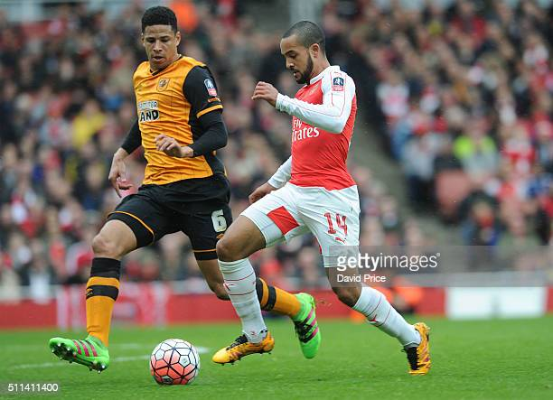 Theo Walcott of Arsenal takes on Curtis Davies of Hull during the match between Arsenal and Hull City in the FA Cup 5th Round at Emirates Stadium on...