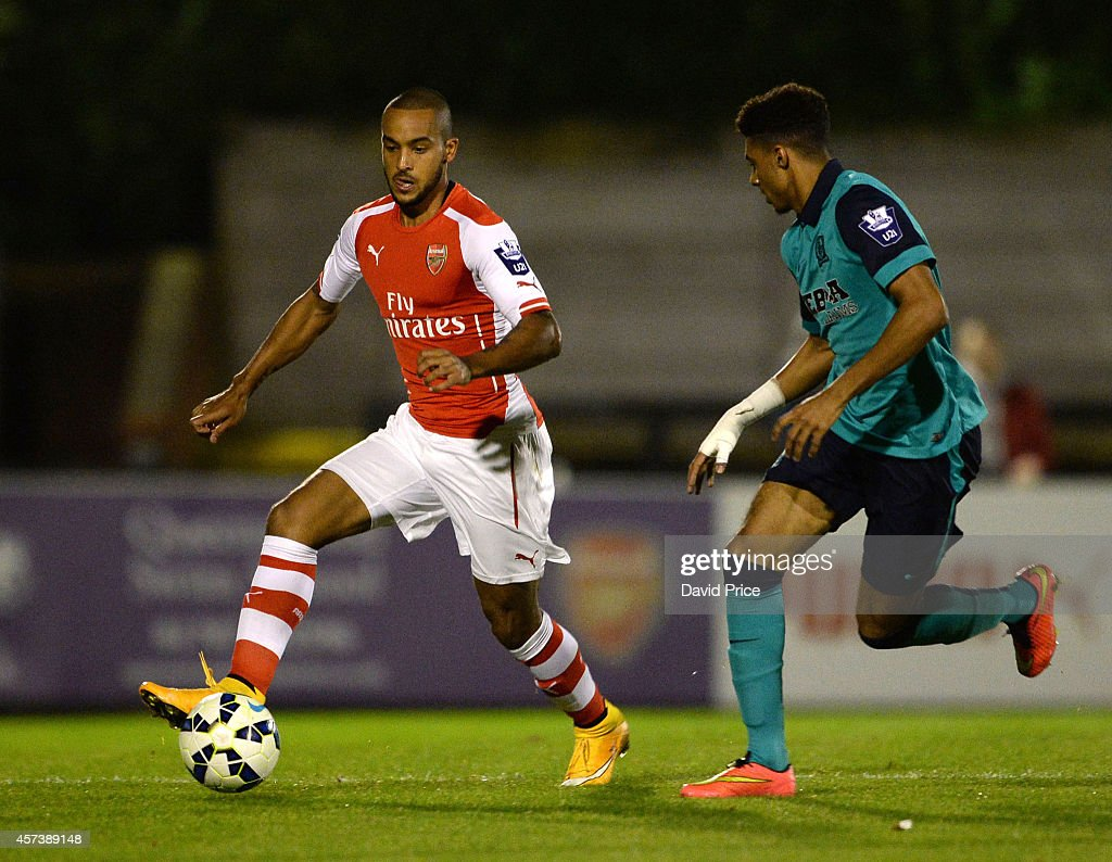 Theo Walcott of Arsenal takes on Devarn Green of Blackburn during the match between Arsenal U21 and Blackburn U21 in the Barclays Premier U21 League at Meadow Park on October 17, 2014 in Borehamwood, England.