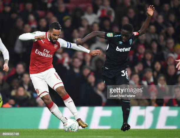 Theo Walcott of Arsenal takes on Domingos Quina of West Ham during the Carabao Cup Quarter Final match between Arsenal and West Ham United at...