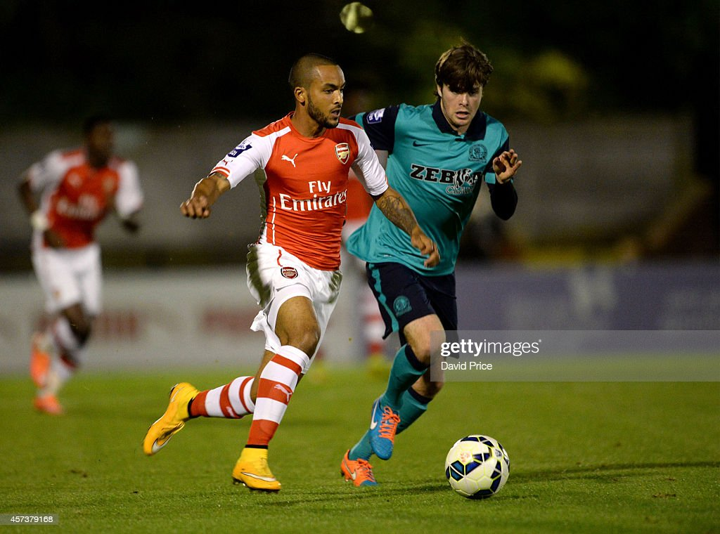 Theo Walcott of Arsenal takes on Hyuga Tanner of Blackburn during the match between Arsenal U21 and Blackburn U21 in the Barclays Premier U21 League at Meadow Park on October 17, 2014 in Borehamwood, England.