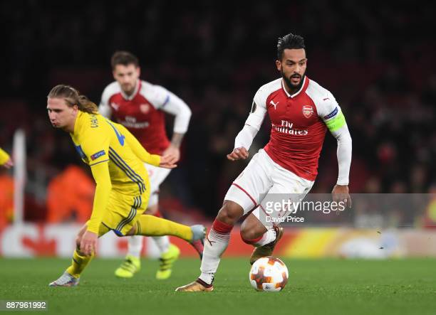 Theo Walcott of Arsenal takes on Maksim Volodko of Bate during the UEFA Europa League group H match between Arsenal FC and BATE Borisov at Emirates...