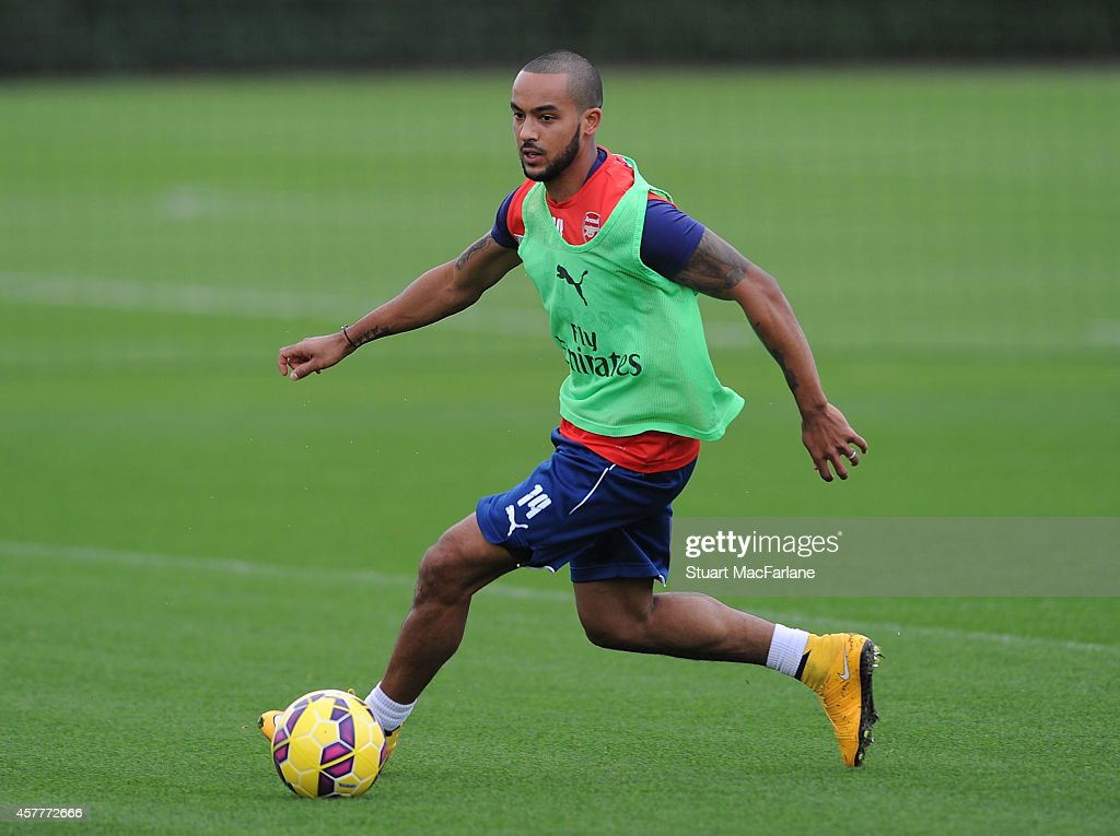 Theo Walcott of Arsenal takes part in a training session at London Colney on October 24, 2014 in St Albans, England.
