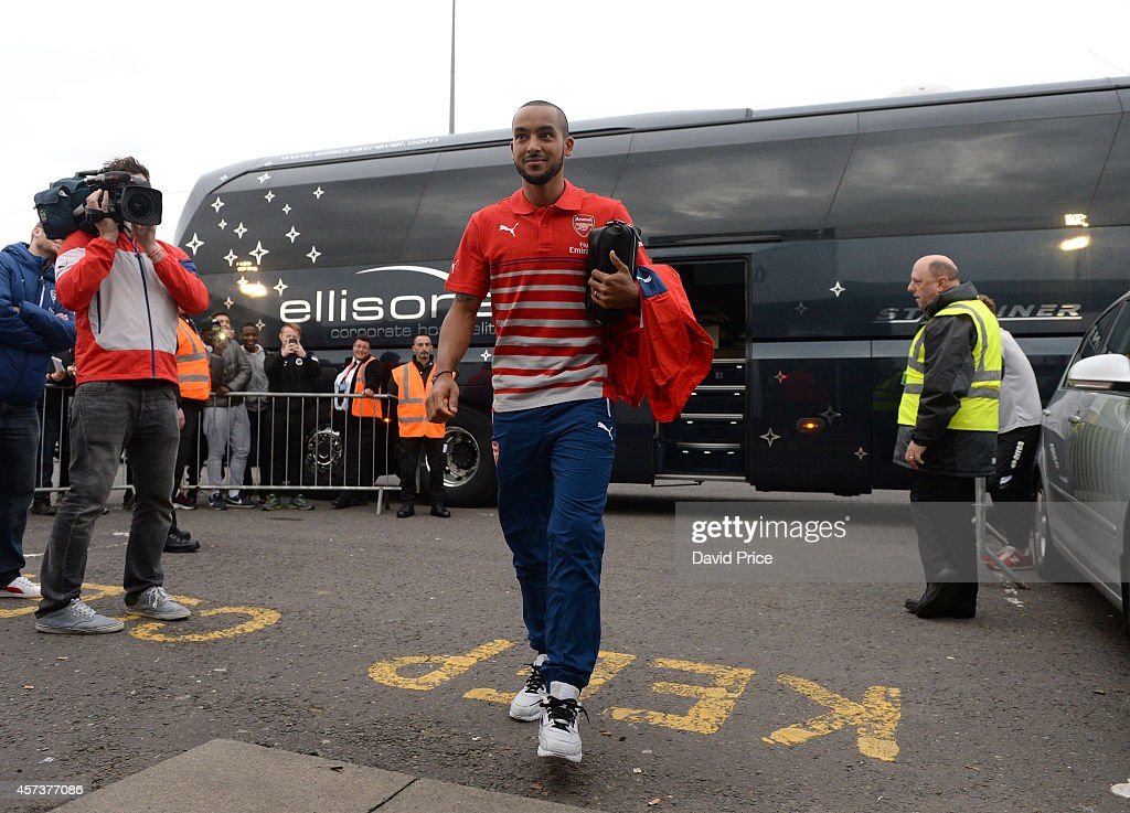 Theo Walcott of Arsenal walks into Meadow Park Stadium before the match between Arsenal U21 and Blackburn U21 in the Barclays Premier U21 League at Meadow Park on October 17, 2014 in Borehamwood, England.