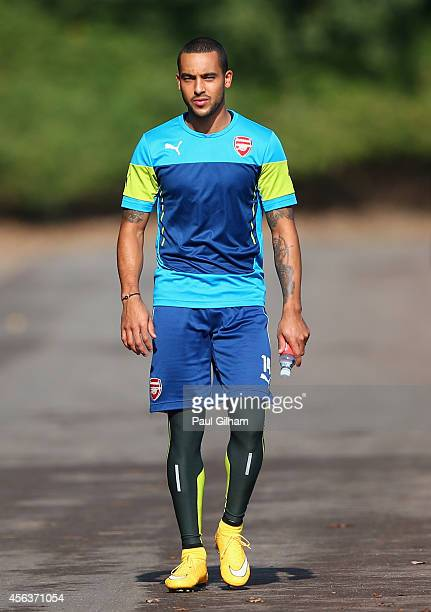 Theo Walcott of Arsenal walks out for training during an Arsenal training session ahead of their UEFA Champions League Group D match against...