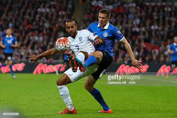Theo Walcott of England and Artur Pikk of Estonia during the UEFA EURO 2016 Qualifier match between England and Estonia at Wembley Stadium on October...