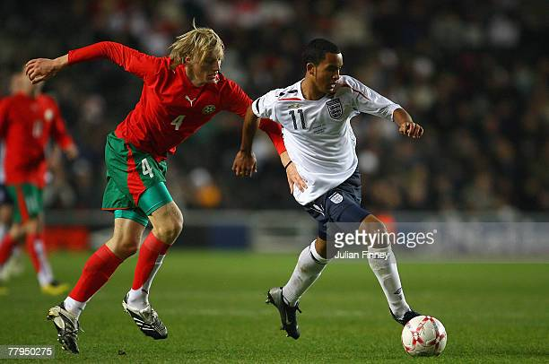Theo Walcott of England battles with Ivan Ivanov of Bulgaria during the UEFA U21 Championship Qualifier Group Three match between England U21 and...