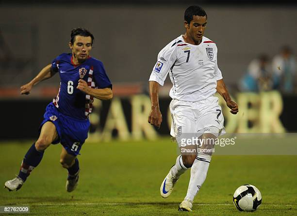 Theo Walcott of England breaks clear to score his hat trick and England's fourth goal during the FIFA 2010 World Cup Qualifying Group Six match...