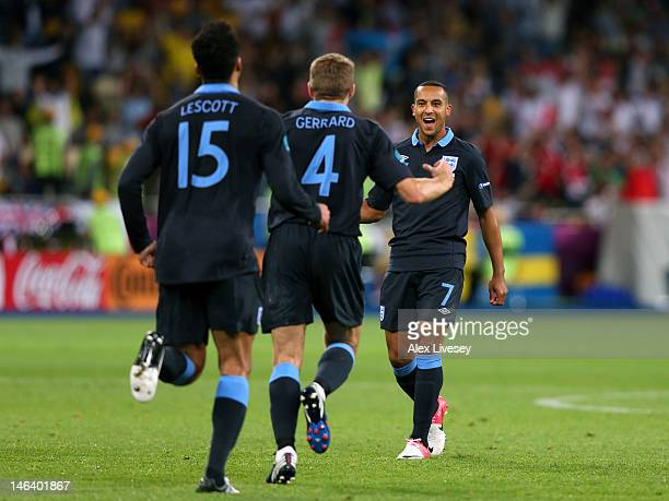 Theo Walcott of England celebrates scoring their second goal during the UEFA EURO 2012 group D match between Sweden and England at The Olympic...