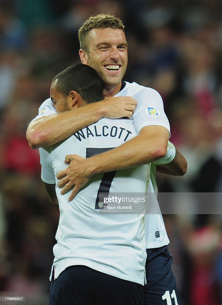 Theo Walcott of England congratulates Rickie Lambert of England on scoring their second goal during the FIFA 2014 World Cup Qualifying Group H match between England and Moldova at Wembley Stadium on September 6, 2013 in London, England.