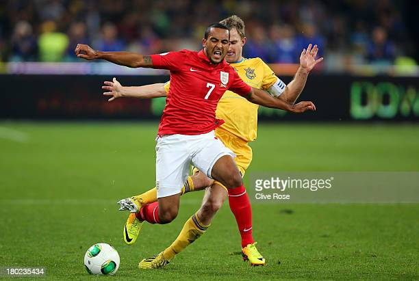 Theo Walcott of England cries out in pain after he is brought down by Oleksandr Kucher of Ukraine during the FIFA 2014 World Cup Qualifying Group H...