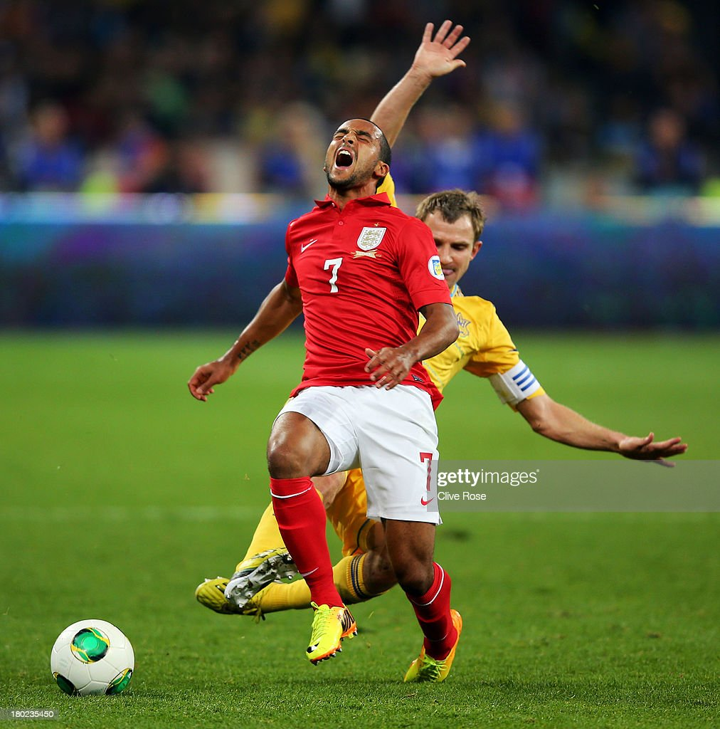 Theo Walcott of England cries out in pain after he is brought down by Oleksandr Kucher of Ukraine during the FIFA 2014 World Cup Qualifying Group H match between Ukraine and England at the Olympic Stadium on September 10, 2013 in Kiev, Ukraine.