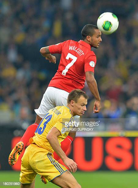 Theo Walcott of England fights for a ball with Vyacheslav Shevchuk of Ukraine during their Brazil 2014 FIFA World Cup qualifiers Group H football...