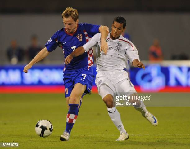 Theo Walcott of England fights for the ball with Ivan Rakitic of Croatia during the FIFA 2010 World Cup Qualifying Group Six match between Croatia...