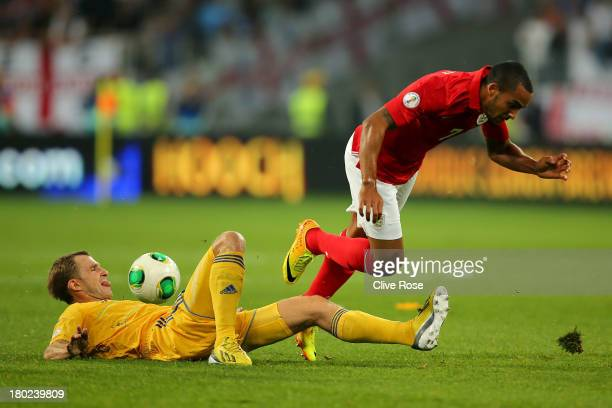 Theo Walcott of England is tackled by Andriy Yarmolenko of Ukraine during the FIFA 2014 World Cup Qualifying Group H match between Ukraine and...