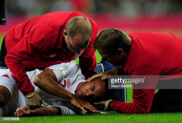 Theo Walcott of England receives assistance after picking up an injury during the FIFA 2014 World Cup Group H qualifying match between England and...
